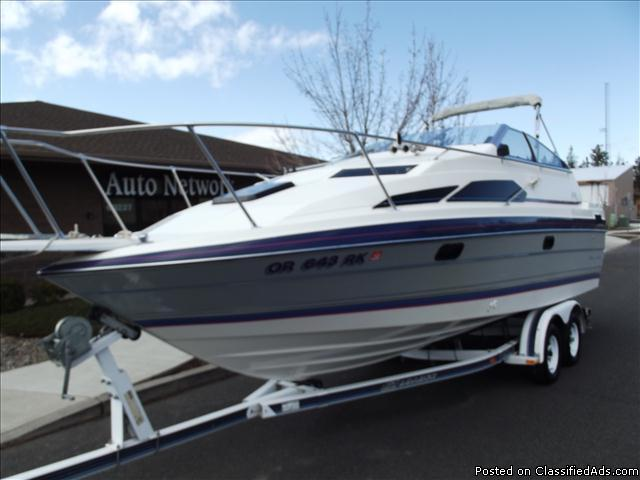 this 1989 Bayliner 2450 runs good and looks good