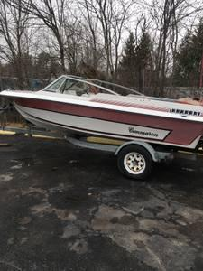 Photo Boat needs engine, selling trailer together.