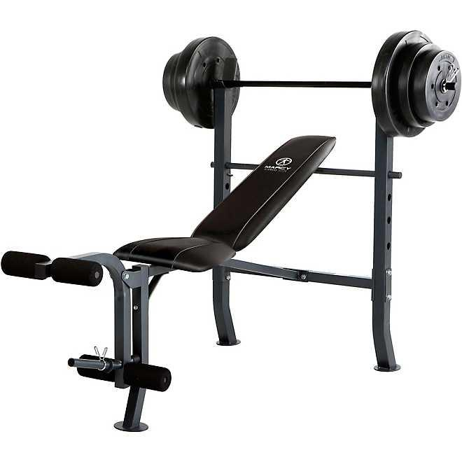 Photo Weight bench with 100lbs of weights. Brand new.