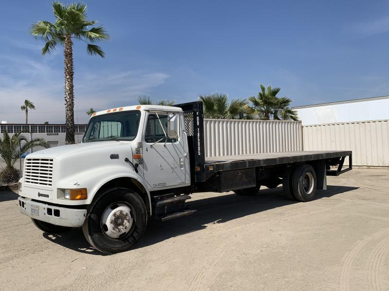 Photo 2000 INTERNATIONAL 4700 FLATBED TRUCK #83801202